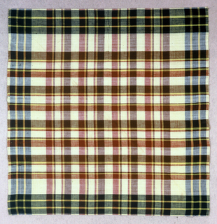 Large check gingham in red, yellow, brown and green.