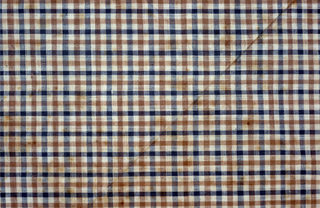 Gingham in blue, brown and white with lines of pink in the border. Hemmed, laundered and stiffly starched.