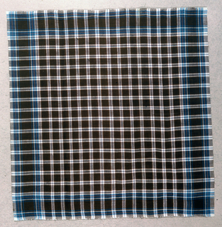 Gingham in brown, blue and white.