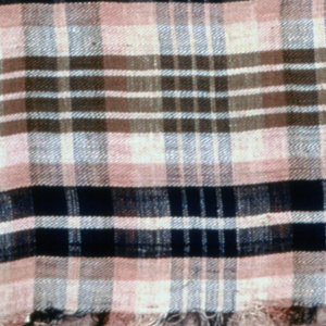 Handkerchief in a coarsely woven plaid of off-white, navy blue, olive green, and pink. Fringed on all four sides.