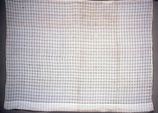 Short window curtain with checks of different weaves, including gauze.