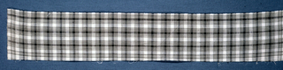 Fragment of gingham in black and white.