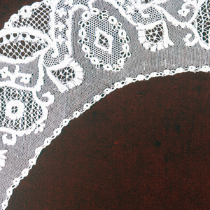 """Deep collar or """"Bertha"""" ornamented with flowers and compartments enclosing various stitches."""