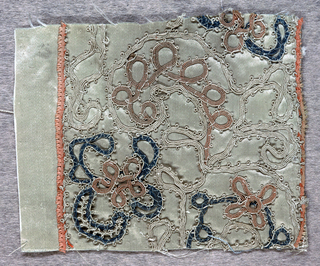 Fragment of cream-colored satin embroidered in a floral pattern of blue, rose and cream. Edged top and bottom with narrow picot-edged rose ribbon.