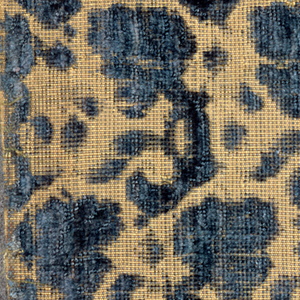 Fragment of blue cut and uncut velvet on tan silk ground. Design of tiny flowering branches. Alternate horizontal rows pointing right and left.