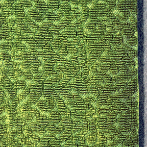 Fragment of chartreuse green uncut velvet on silk ground of same color. Intricate design of closely spaced, tiny flowering branches in varied forms alternating in direction.