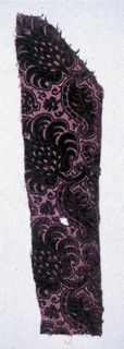 Fragment of deep purple cut and uncut velvet on self-colored satin ground. Design of large-scale branches with leaf and blossom. One horizontal row of design remains with branches curving to the left.
