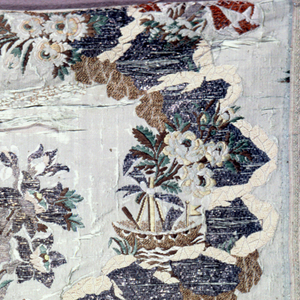 Pale blue-green silk grosgrain with broad ribbon-like serpentine brocaded in silver and gold frisee, ivory and tan silks. Large floral sprays in polychrome silks and metal spring. Ship, with floral sprays tied to mast, in curve of serpentine.