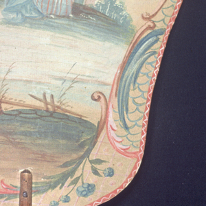 Handscreen with a hand-painted paper leaf and turned wood handle.  Obverse: man and woman in landscape. Reverse: building with tower in landscape.