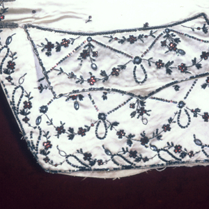Front panel of a gentleman's waistcoat embroidered in a delicate foral design on white satin.
