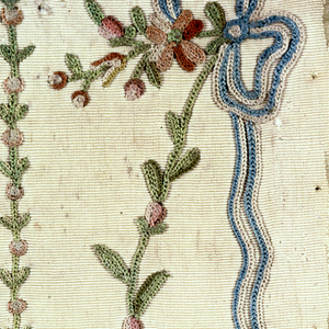 Fragment of finely-ribbed white silk embroidered in multicolored silks in a design of a flowering vine tied with a bowknot of blue ribbon.