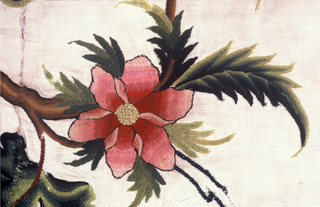Design of flowers and fruits in bright colors on undulating brown stems.