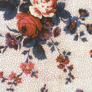 """Mezzaro in a multicolored design on an ivory ground. Ground of swirling lines with realistically-rendered floral sprays and a floral border. Initials """"C.P."""" embroidered in red cross stitch in upper right corner."""