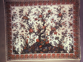 Mezzaro in a multicolored design on a white ground. Center shows a large scale flowering tree flanked by a smaller tree on either side. Floral sprays, animals, insects, and birds are scattered over the ground. Border design is repeating horns with floral sprays.