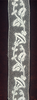 Curving stem with leaves and flowers on diamond mesh.