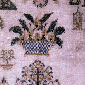 Ornamental border enclosing detached motifs including Adam and Eve, a shepherd and shepherdess, bird in a cage, baskets of flowers, lobster, etc.