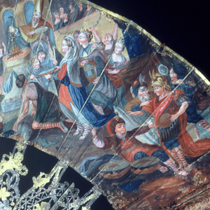 Pleated fan with painted paper leaf. Obverse center: King, Queen and court with gods; at right: priest holding a cross over the fire and Turkish figures. Reverse: outdoor scene with man, woman and soldier in front of tent. Silvered, and gilded ivory sticks carved à jour with putti, courtiers and flowers.