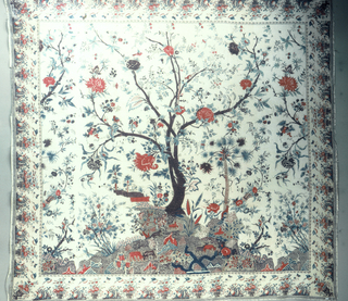 Mezzaro in a multicolored design on a white ground.  Formed of three panels stitched together. Large-scale tree with a border of alternating bunches of fruit and vases with flowers.