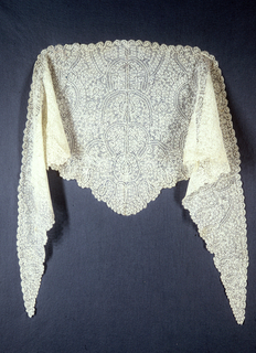 Peasant-style lace with pattern  of curving and scrollong lines.