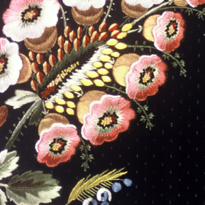 Multicolored silk embroidery in a floral design on a dark purple ground with a small purple dot design.