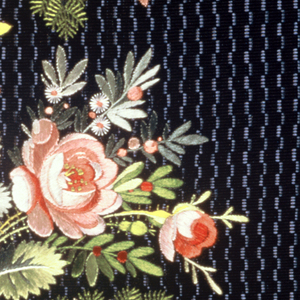 Multicolored silk embroidery in a floral design and net applique on a dark purple ground with wavy vertical blue stripes.