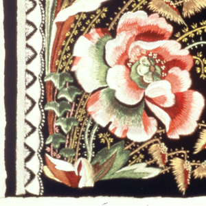 Green cut ground embroidered in a border design of naturalistic roses in shades of pink, green, tan, yellow and white. Knot stitches used for accent.