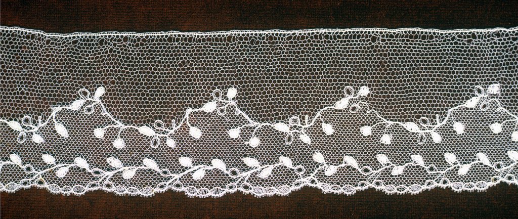 Blonde lace border showing delicate leaf vine pattern with two sizes of mesh.