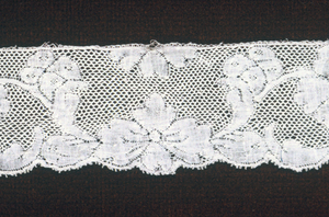 Valenciennes type consisting of a leaf border with carnations and sprays.