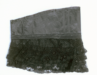 Cuff of black taffeta edged with two ruffles of black Chantilly style lace.