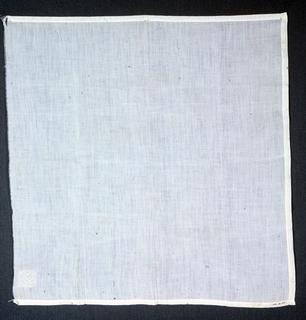 White linen handkerchief with embroidered monogram in lozenge shape in one corner.