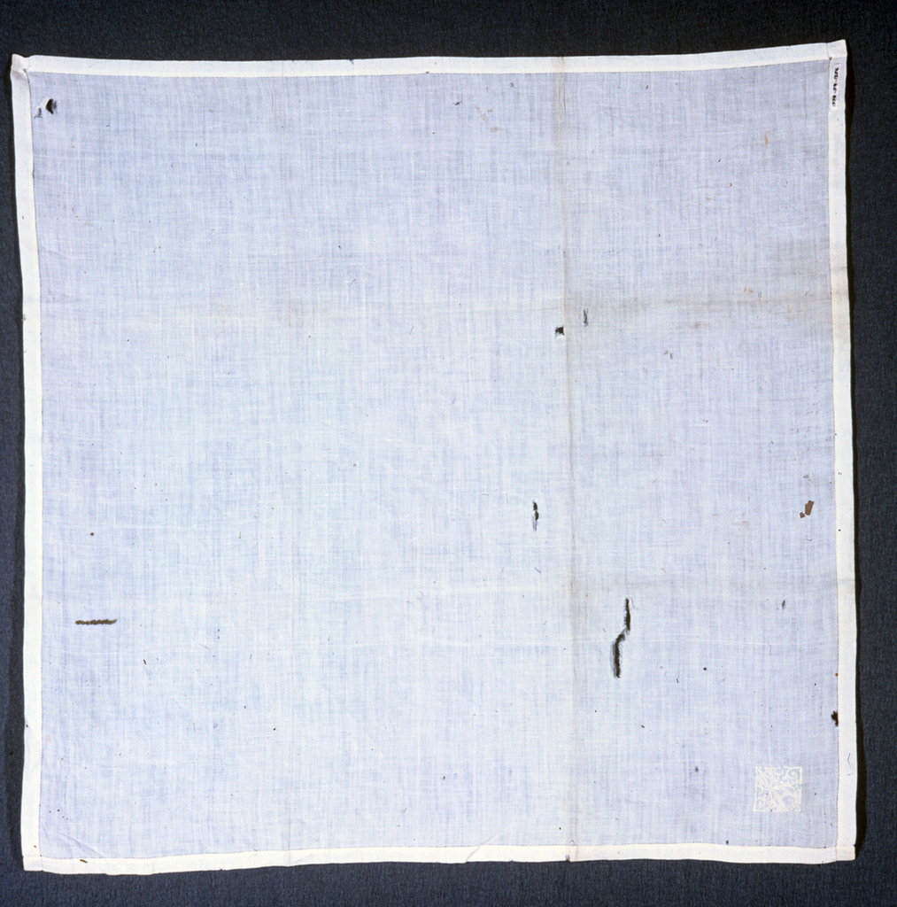 White linen handkerchief with diamond-shaped monogram. S.A.H.