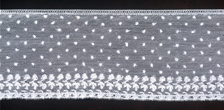 Straight border of Mechlin lace with a design of dots sprinkled in field above border of sprigs with one leaf and one bud above a row of pendant leaves.