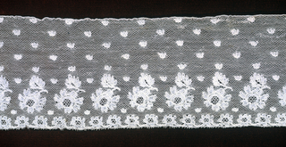 Straight border of Mechlin lace with a design of buds sprinkled over the field, and a border of detached leaf and flower motifs above a row of flowers.