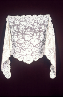 Chantilly-style lace shawl, triangular in shape, in a design of naturalistic flowers and leaves in the field and border.