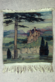 Small tapestry with a landscape with a large pine tree in the foreground. A castle in shades of pink and yellow is in the middle ground, framed by distant mountains in violet and blue. A fringe of the cream-colored warp threads top and bottom.