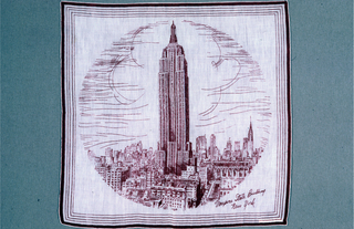Lavender souvenir handkerchief with a scene of Midtown Manhattan showing the Empire State Building and other buildings.