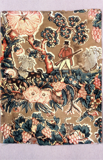 Fragment showing a pattern of a hunter with two dogs in a field of flowers with sheaves of wheat under a flowering tree. Colors are red, blue, yellow and dark brown on a light brown ground.