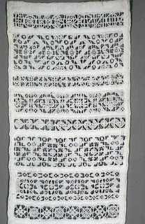 Twenty-seven cross borders, all in white. Text is worked into the bottom band,
