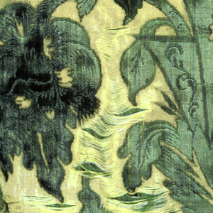 Pilaster-like pattern of large-scale leaves and flowers in green ciselé velvet on yellow satin ground.  Satin ground originally shot through with flat strips of gold, which is now almost entirely worn away.