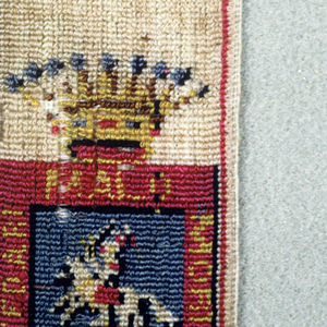 Two shields, each under one crown.  One shows a Maltese cross in each of two quarters and a tree with two small animals in each of two quarters.  The other shield shows a horseman with a motto.  Colors are blue, purple, green, yellow, and black on a white ground.