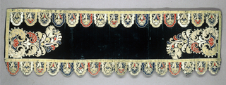 Horizontal panel with scallops at the lower edge. Green velvet with appliquéd ornament in the design of conventionalized flowers in blue, red, yellow and white.