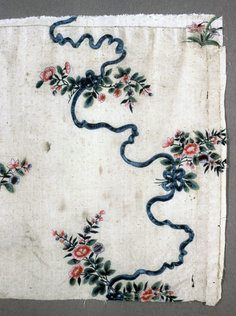 Fragment of yellow silk painted in polychrome tempera in a pattern of a spray of roses, some held in place by ribbons and connected with another spray.