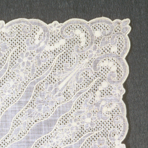 """Handkerchief with embroidery in a floral design arranged as a border and running in toward the center in points and the monogram """"MMB."""""""