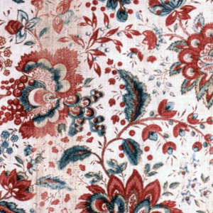 Allover design of flowers in red and blue with dark brown outlines.