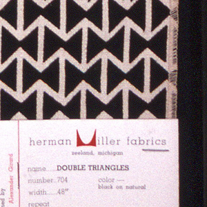 Rows of two triangles facing each other forming a bow tie shape, with alternating rows of off- set repeat. Printed in black on natural.