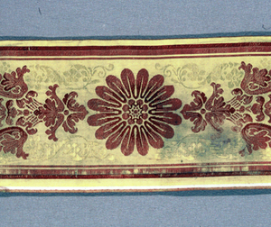 Gold-colored border with Empire design in red.