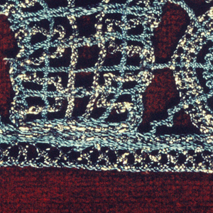 Short piece of bobbin lace, green silk and silver gilt thread. Design in scallops.