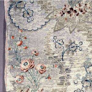 Floral sprays and scalloped lines in blue silk.