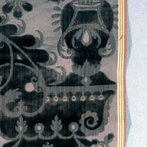 Purple cisele-style reproduction velvet with a design of a floral arch and a large central motif.