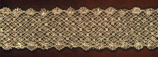 Bobbin lace made with metallic strips and metallic thread in gold color. A lattice pattern with scalloped borders.